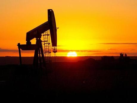 Crude oil gushing from shale fields in North Dakota is a major factor in the surge in domestic oil production. The surplus has led to a debate over whether it is time to lift US restrictions on oil exports.